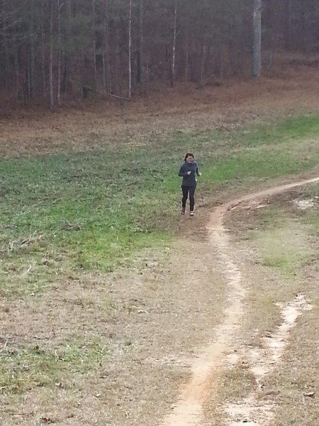 My wife (ha ha ha Borat), running through the clearing.