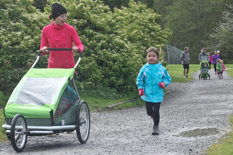 A little runner enjoys a flat section of the Lake Padden Loop.