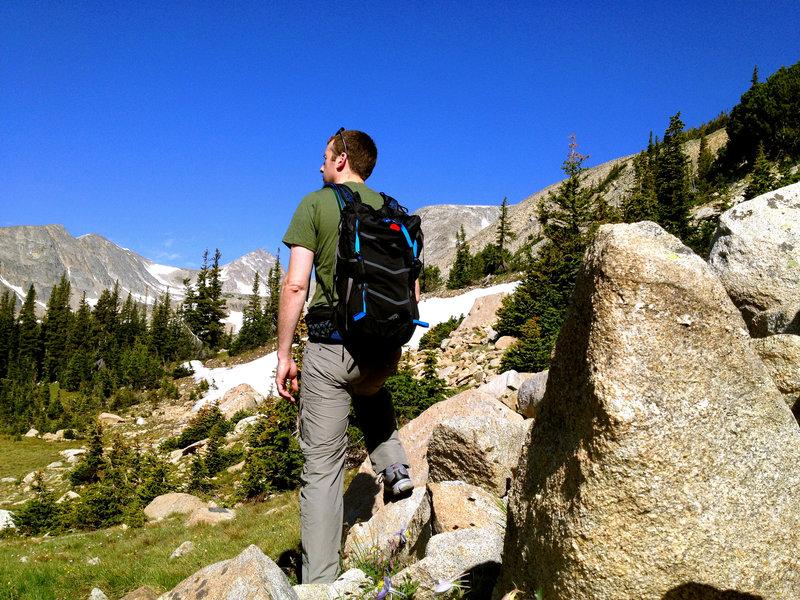 A hiker, blocking the stunning view of Mount Audubon.