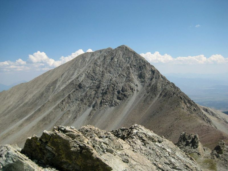 Taken from the summit of nearby 13er Iron Nipple, this picture shows Mt. Lindsey Trail leading up into the gully. The alternative ridge can also be seen on the right side of the mountain.