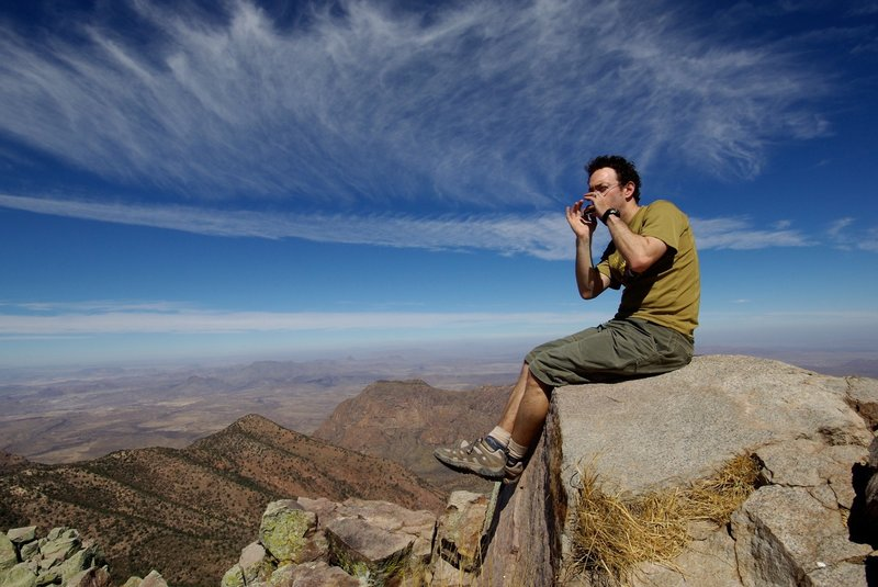 Playing the harmonica on Emory Peak