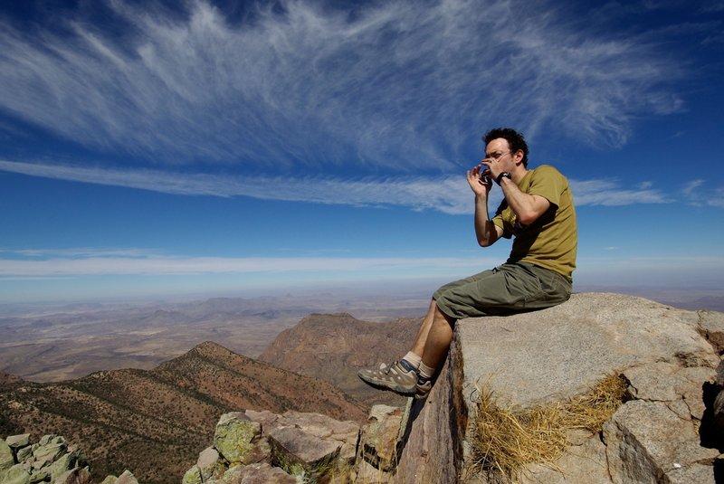 Playing the harmonica on Emory Peak