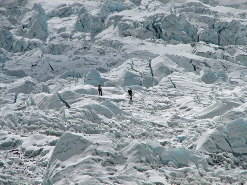 Climbers descending through icefall