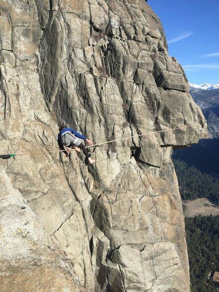 Slackliner at the top of Yosemite Falls