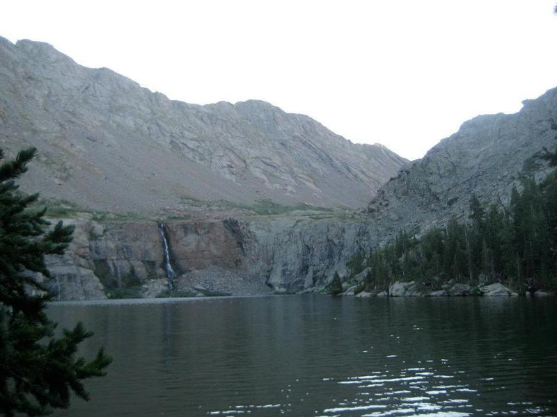Willow Lake, its cliffs, and waterfall. Kit Carson and Challenger are up to the right, obscured from view.