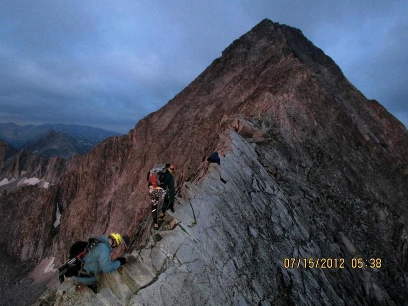 Crossing the knife edge at sunrise, with Capitol Peak looming ahead.