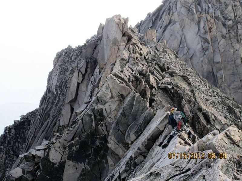 Coming back across the knife edge after a successful summit.