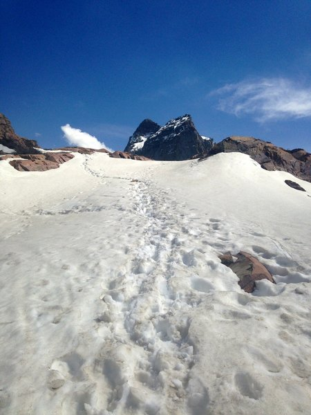 Slight snowpack scramble up to lake area in early May