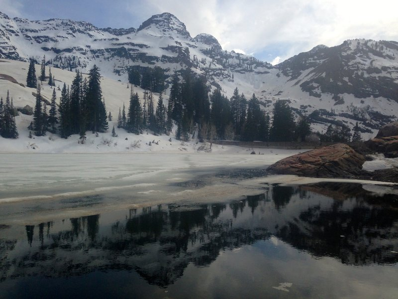 View of Lake Blanche and surrounding peaks in early May