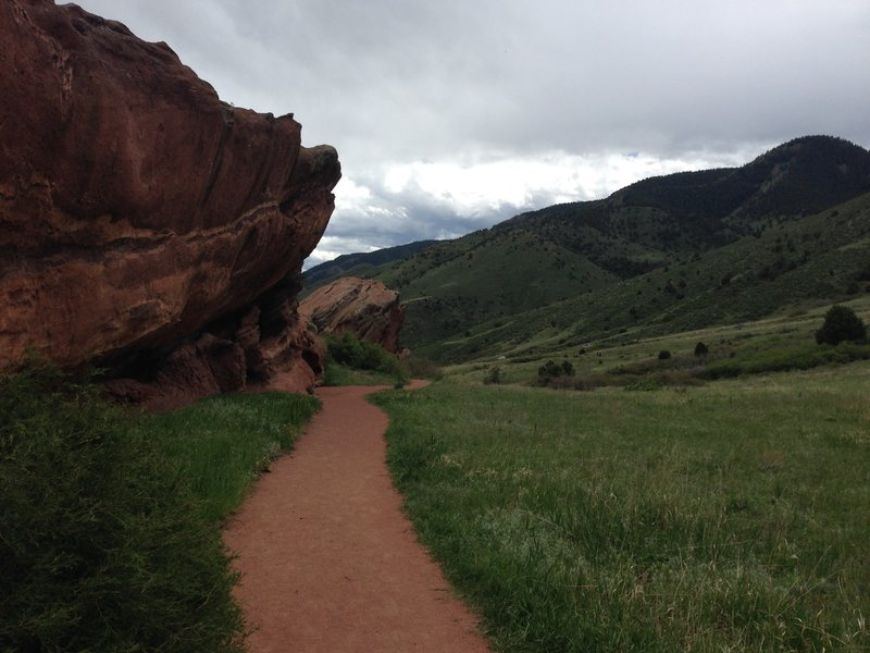 An amazing rock face and southern hills on the Trading Post Loop Side Trail at Red Rocks Park and Amphitheater.