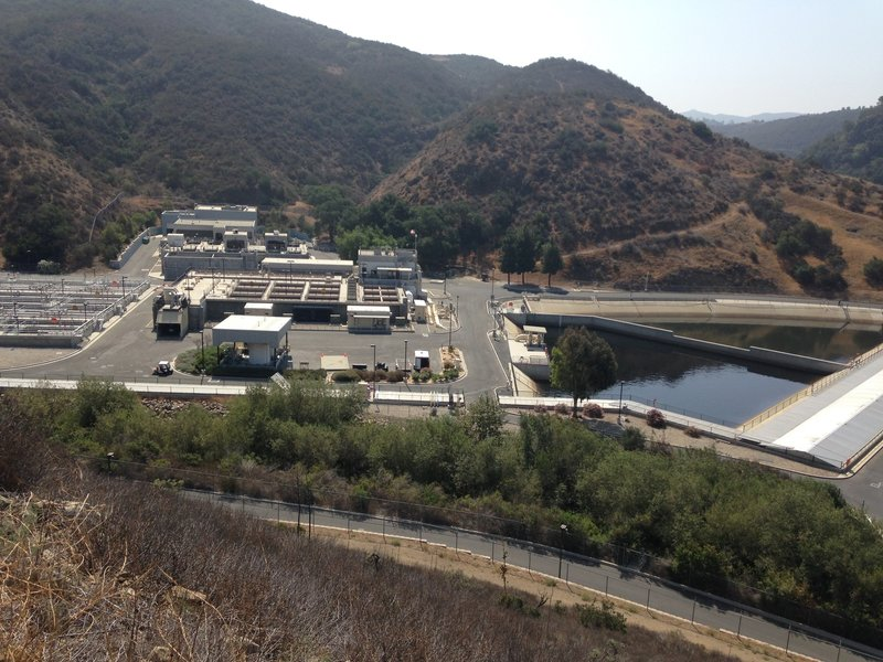 The water treatment plant along the back side of the park.