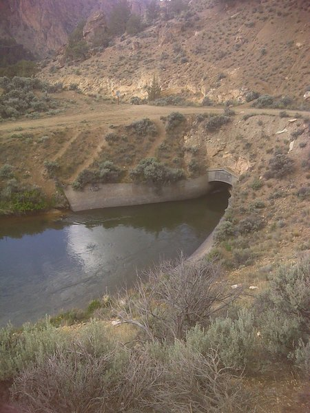 Irrigation ditch goes underground, don't let children or dogs fall in.