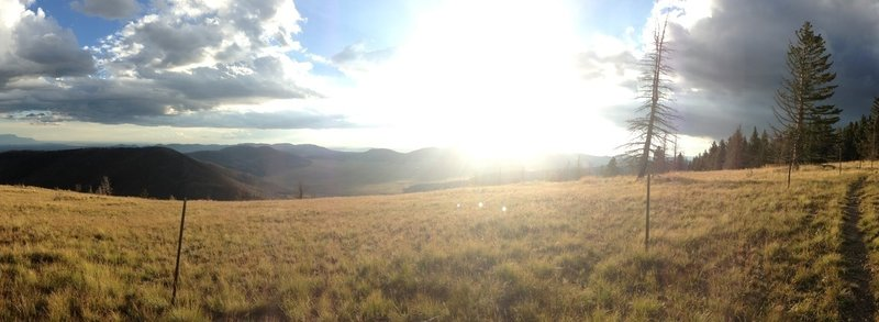 Sunlight spilling through the clouds slowly filling the Valles Caldera.