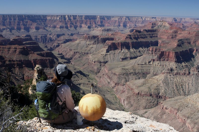Resting at Komo Point.  The ball is a reference point used by Bradford Washburn during his aerial photography used to map the Grand Canyon.  (photo by brewbooks)