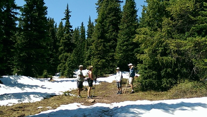 The treed sections of the trail hold snow a long time