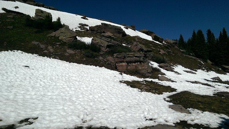 Huge chunky boulders below the ridge