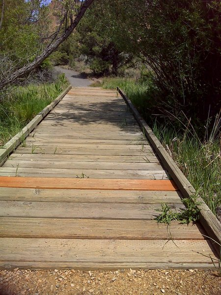 Board walk over creek.