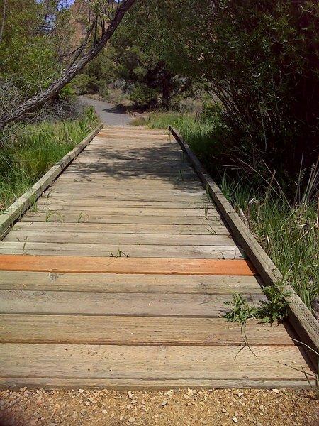 Board walk over creek.