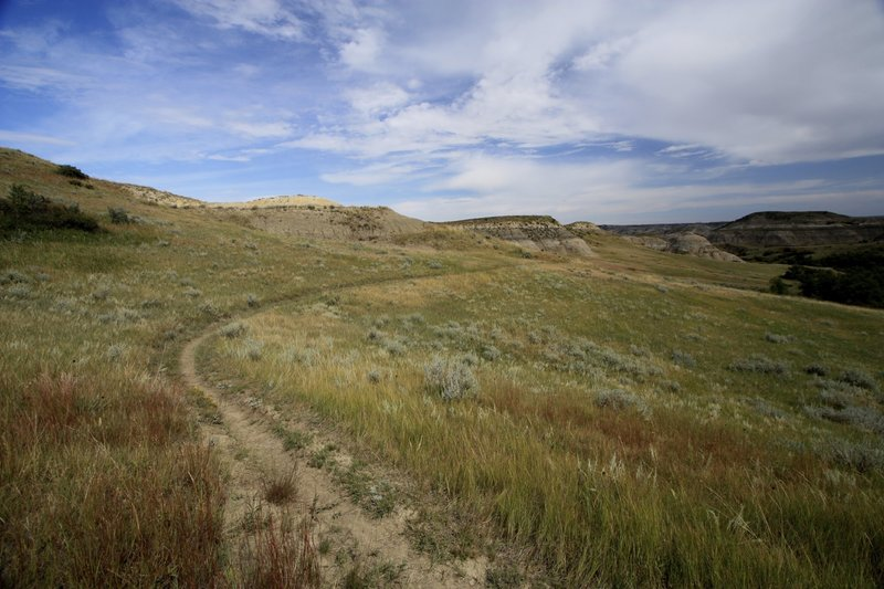 Epic singletrack of the Maah Daah Hey trail winding through the painted hills of the badlands.