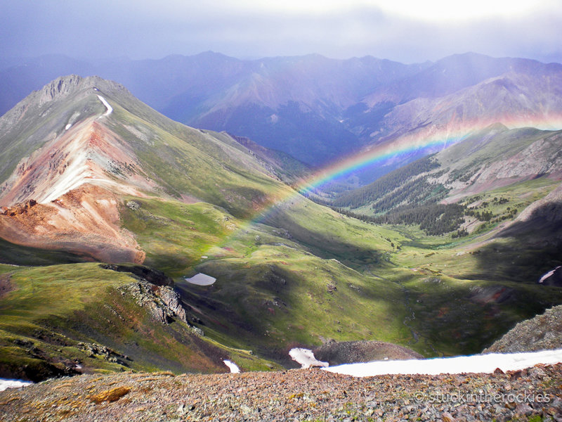 Near the summit of Handies Peak, 14,048 ft., the high point of the race course. A passing storm created a rainbow over Grizzly Gulch. July 2009.