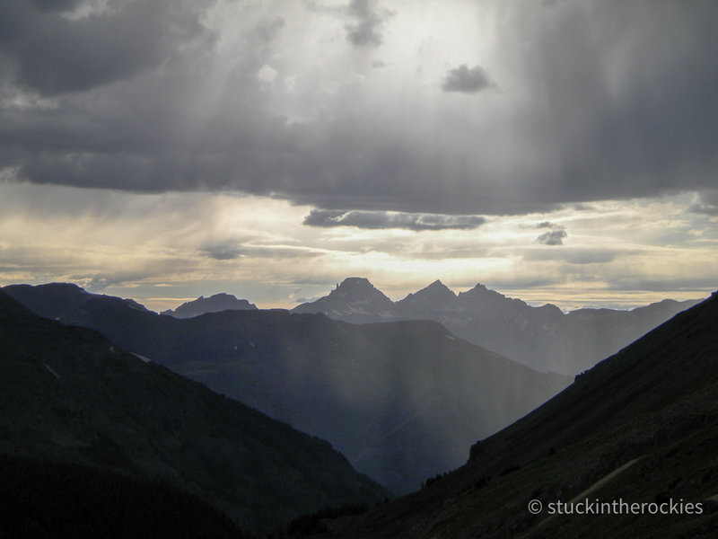 View to the west form near the top of Engineer Pass. Potosi Peak, Mt. Sneffels, and Teakettle Mountain are in silouhette.