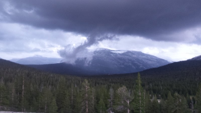 Storm rolling over Mammoth Mountain as seen in Tuolumne Meadows