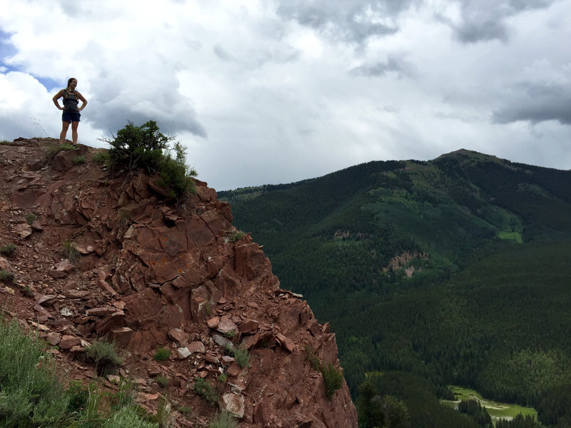 Taking in a spectacular view at an overlook atop final descent. Enjoy, but watch for loose rocks / exposure.