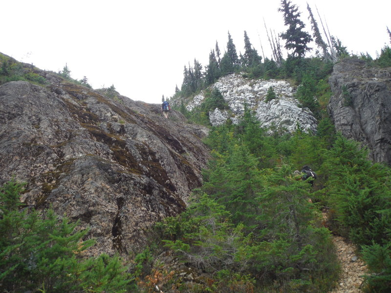 A look upward to the remaining bluffy portion of the trail. Although it looks exposed, the route has good friction on the rock.