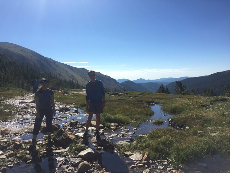 Working our way over one of the soggier areas of Arapaho Pass Trail.
