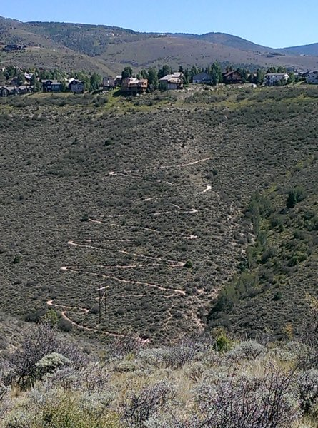 The switchbacks of the Wilde West Ridge Trail from across the valley.