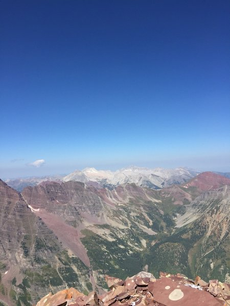 Snowmass and Capitol from the summit. The Maroon Bells (not pictured) rise majestically on the left, and the views into valleys a mile below are incredible.