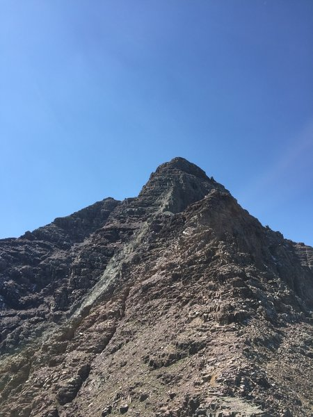 """Most of the route is visible from the saddle at 13K. The light green rock composing a rib from the summit, AKA the """"green gully"""" is a major route finding landmark."""