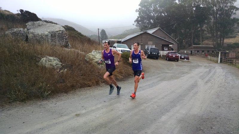 The men's leaders cruising through the fog.