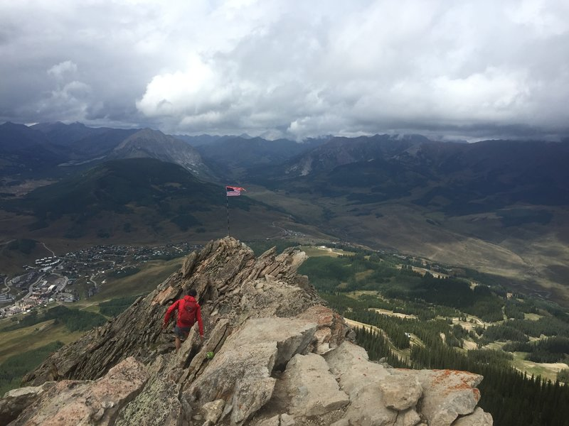Scrambling to the American flag just off of the Mt. Crested Butte summit.