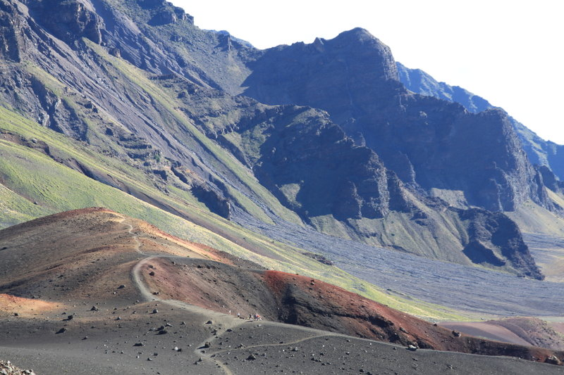 Red cinder cone below green/lavender slopes of Haleakala.