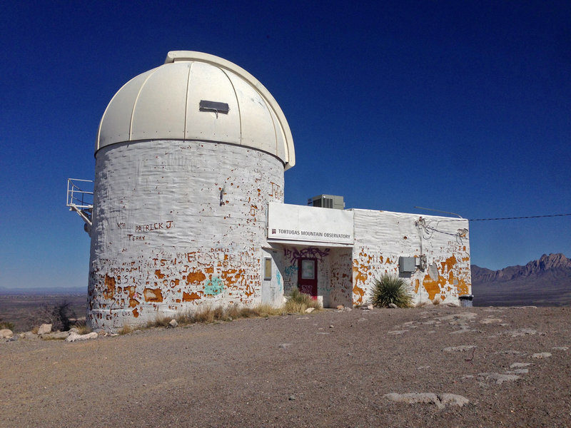 The New Mexico State University observatory located at the top of A Mountain, near Turtleback Trail.