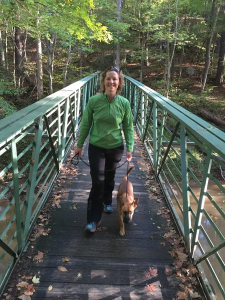 Heather and Paco on the bridge that crosses Crabtree Creek.