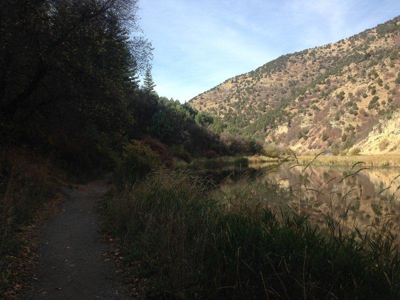 The trail winding west around Third Dam.