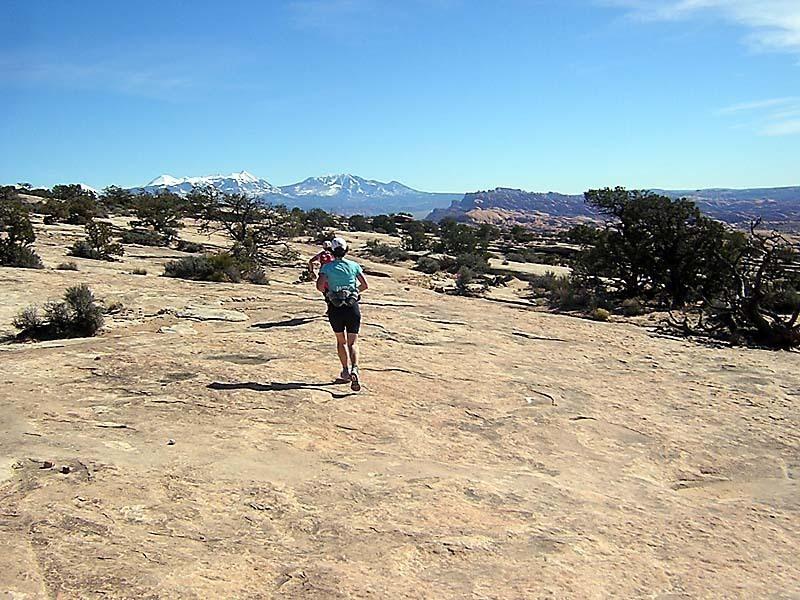 Running along the slick rock.