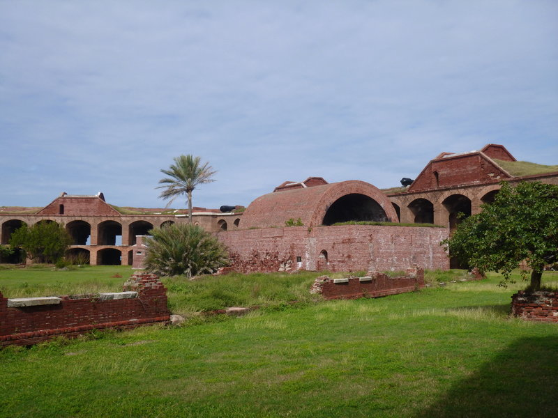 Standing in the inner grounds, looking toward the powder magazine with the arched roof.