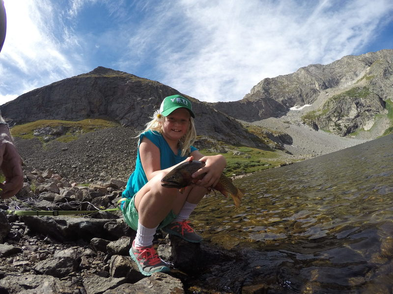 KT with a giant hybrid cutthroat trout from Upper Sand Creek Lake.