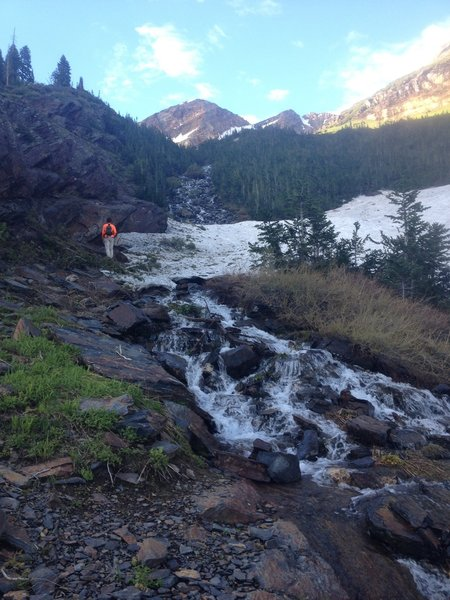 Snow patches turn to a meltwater stream before our eyes in late June.
