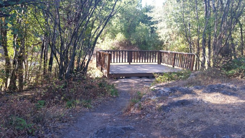 An observation platform by the pond allows for low-impact enjoyment of the aquatic area in the Dishman Hills Natural Area.
