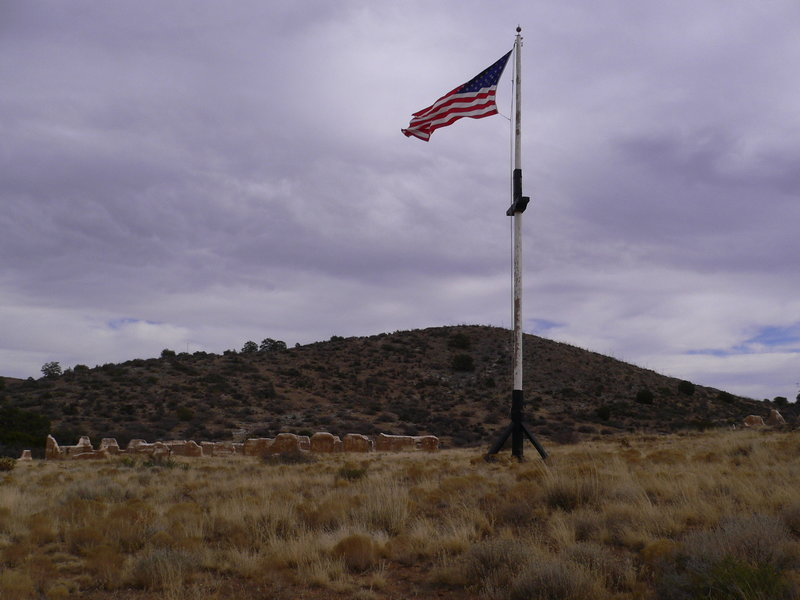 Flag flying among ruins at Fort Bowie.