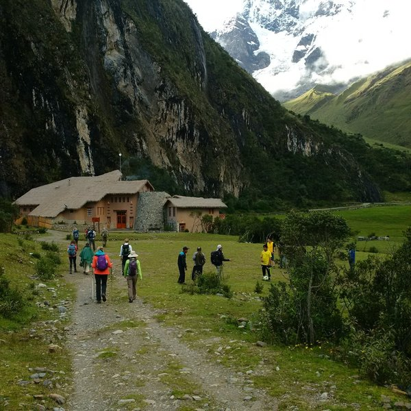 Approaching the Salkantay Lodge with the mountains of the Andes in the background.