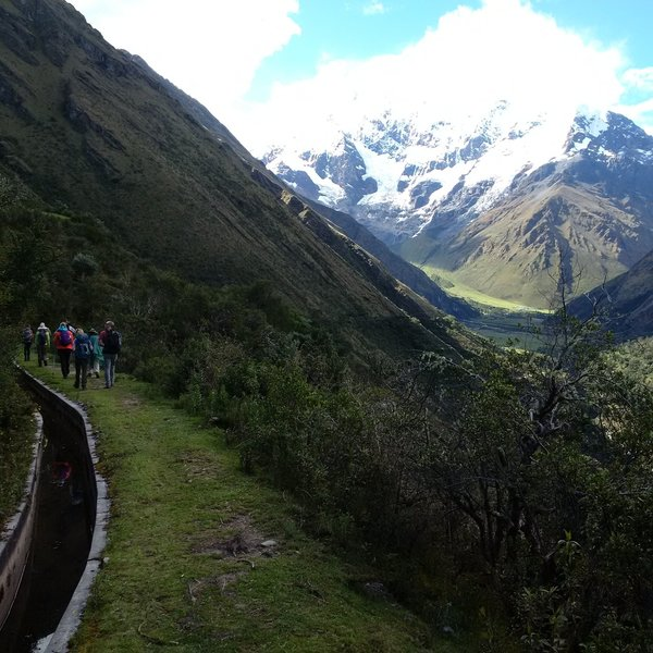 A view of Salkantay Mountain while walking the trail. The Incan irrigation system can be seen to the left.
