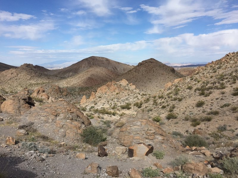 Looking north back down the 300 Trail that you just climbed--The Strip can be seen on the left and west. Henderson/ Anthem-Inspirada areas can be seen on the right.