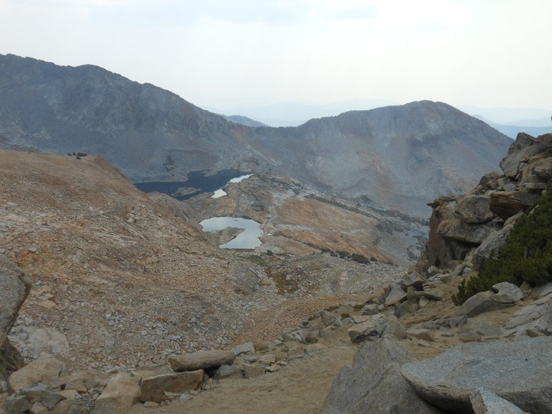 Looking south through smoke from fires from Red Peak Pass toward Upper Ottoway Lake.