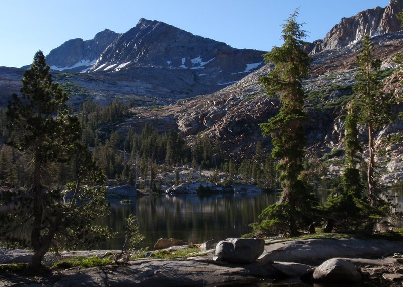 Lower Ottoway Lake peeks out from the Red Peak Pass trail.