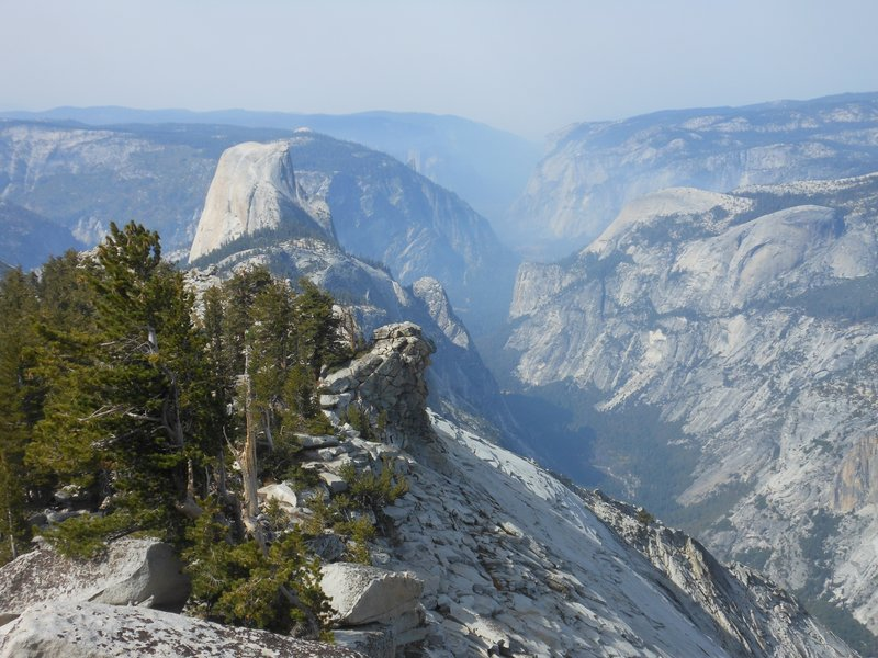 Westward view of Yosemite Valley, Half Dome, Tenaya Canyon, and smoke from fires from Clouds Rest.
